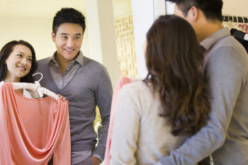 Young couple shopping in clothing store