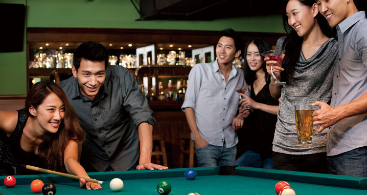 Friends Playing Pool at a Bar