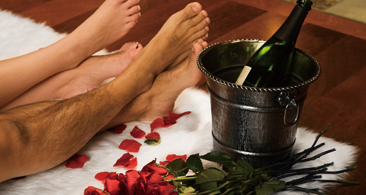 Bare Legs with Valentine Roses, Champagne and Fireplace, Copy Space