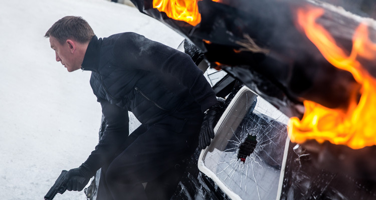 Bond (Daniel Craig) leaping from the sliding damaged plane gun drawn; Obertilliach, Austria in Metro-Goldwyn-Mayer Pictures/Columbia Pictures/EON Productions' action adventure SPECTRE.