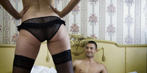 Young Woman Tempting Her Man with Spread Legs