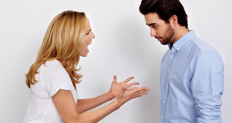 Young couple arguing on white background
