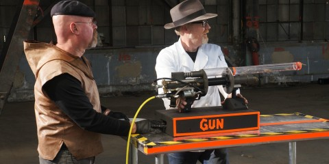 Hosts Jamie Hyneman and Adam Savage at the shrimp gun section of the shrimp cooker.