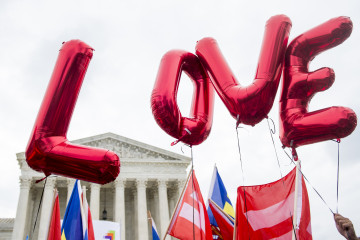 "UNITED STATES - JUNE 26: Same-sex marriage supporters from the Human Rights Campaign fly ""LOVE"" balloons in front of the U.S. Supreme Court as they wait for the court's decision to legalize same-sex marriages nationwide on Friday, June 26, 2015. (Photo By Bill Clark/CQ Roll Call)"