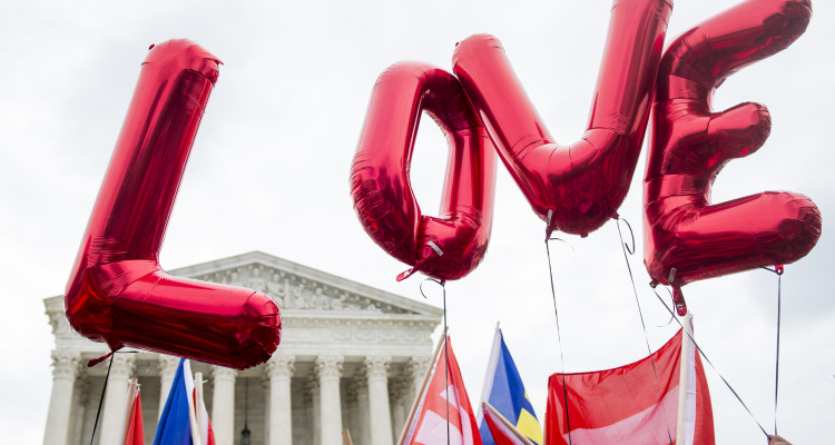 """UNITED STATES - JUNE 26: Same-sex marriage supporters from the Human Rights Campaign fly """"LOVE"""" balloons in front of the U.S. Supreme Court as they wait for the court's decision to legalize same-sex marriages nationwide on Friday, June 26, 2015. (Photo By Bill Clark/CQ Roll Call)"""