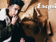 墨綠色長版大衣_$235,000 by Salvatore Ferragamo;紅色針織衫_$17000、黑色牛仔褲_價格電洽 by Versace。