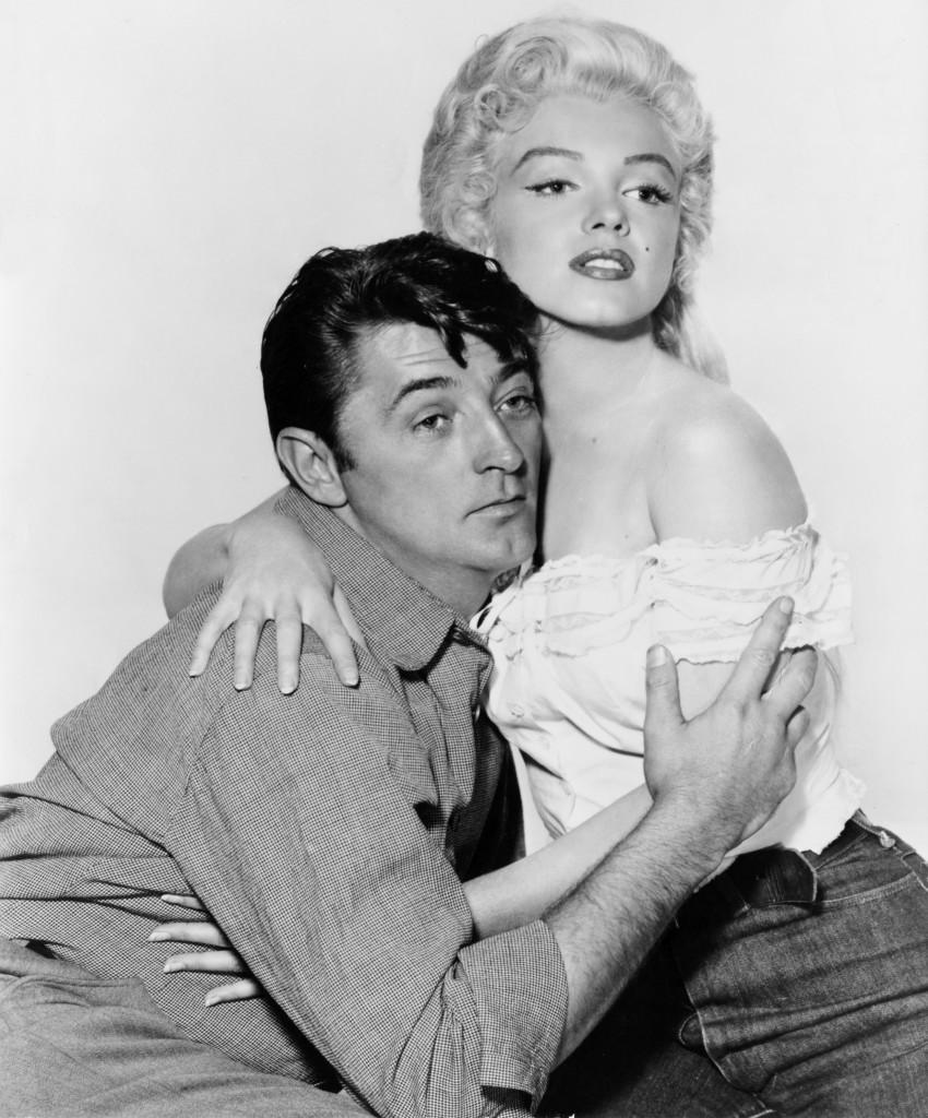 Marilyn Monroe也有牛仔褲的搭配,無論是白襯衫還是平口洋裝,都展現俏麗氣質。/Images of Getty Images